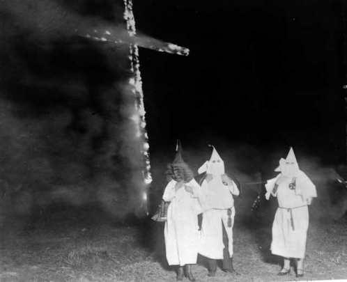 Ku Klux Klan members burning a cross in Denver, CO in 1921. Wiki Commons